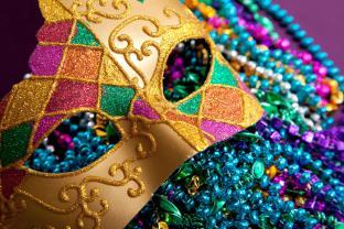 bigstock-Gold-Mardi-Gras-Mask-And-Beads-6507277